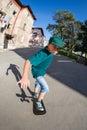Boy riding a skateboard on the street. Royalty Free Stock Photo