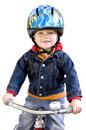 Boy riding tricycle Stock Photos