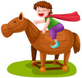 Boy riding wooden horse Royalty Free Stock Photo