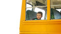 Boy rising school bus on white background a young is a yellow a isolated for an education concept Stock Photo