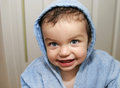 Boy with robe after bath Stock Photography