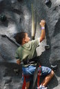 Boy rock climbing Royalty Free Stock Photo