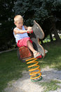 Boy and rocking Horse Stock Image