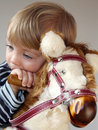 Boy on rocking horse Stock Images