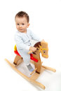 Boy on a rocking horse little Stock Image