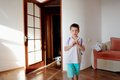 Boy in the room little blue shorts standing bright sun Royalty Free Stock Photography