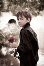 Boy with rose in his hand Stock Image