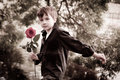 Boy with rose in his hand Royalty Free Stock Image