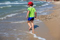 Boy running on beach Stock Photography