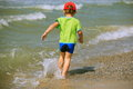 Boy running on beach Stock Image