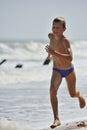 Boy running on the beach Royalty Free Stock Photo