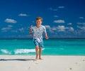 Boy running on beach Royalty Free Stock Photo