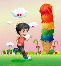 A boy running in the candyland Royalty Free Stock Photo