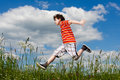 Boy running, jumping outdoor Stock Photo