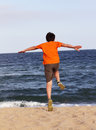 Boy running to the sea on summer holidays Royalty Free Stock Photography