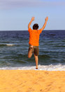 Boy running to the sea on summer holidays Royalty Free Stock Image