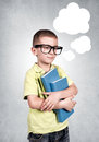 The boy s thoughts imaginary little with books in hand Royalty Free Stock Photos
