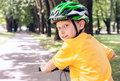 Boy in safe helmet on bicycle Royalty Free Stock Photo