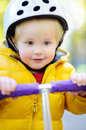 Boy in safety helmet to ride scooter Royalty Free Stock Photo