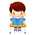 The boy sat down on the chair is reading a book on the desk ed education and life character design series Royalty Free Stock Photo