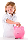Boy saving money in a piggybank isolated over white Royalty Free Stock Photography