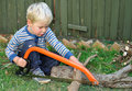 Boy sawing, seriously Royalty Free Stock Photography