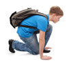The boy of school age with a back pack is going to run a white background Stock Photos