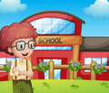 A boy with a school building at his back illustration of Royalty Free Stock Image
