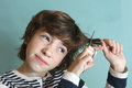 Boy with scissors try to cut his hair Royalty Free Stock Photo
