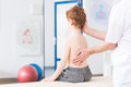 Boy with scoliosis during rehabilitation little in clinic physiotherapist working special method on s spinal column Stock Image