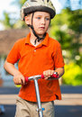 Boy with scooter cute young Royalty Free Stock Photos