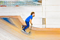 Boy with scooter is going airborne in the skate hall Royalty Free Stock Photos