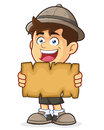 Boy scout or explorer boy holding a blank map vector clipart picture of cartoon character Stock Image