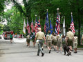 Boy Scouts march in Fourth of July parade Royalty Free Stock Image