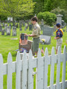 Boy scouts on memorial day placing american flags the graves of fallen soldiers Royalty Free Stock Images