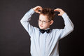 Boy scratching his head thinking on black background Stock Images