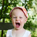 Boy screaming baby year on nature background Royalty Free Stock Images