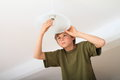 Boy screwing bulb concentrated on a lamp Stock Photography