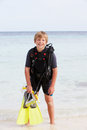 Boy with scuba diving equipment enjoying beach holiday smiling to camera Royalty Free Stock Photo