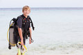 Boy with scuba diving equipment enjoying beach holiday smiling to camera Royalty Free Stock Photos