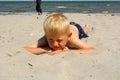 The boy on the sea beach lies Stock Image
