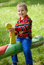 Boy on the seesaw Royalty Free Stock Image