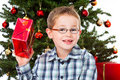 Boy shaking a christmas gift Royalty Free Stock Images