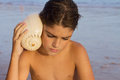 Boy with shell Royalty Free Stock Image