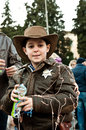 Boy sheriff fancydressed in Piazza del Popolo Royalty Free Stock Photo