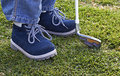 Boy shoes and golf club on grass Stock Photography