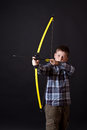Boy shoots a bow Stock Photos