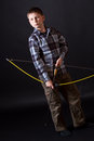 Boy shoots a bow Stock Image