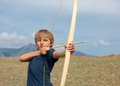 Boy shoots a bow at a target Royalty Free Stock Photos