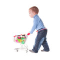 Boy and shopping plays with trolley toys isolated on white Stock Images